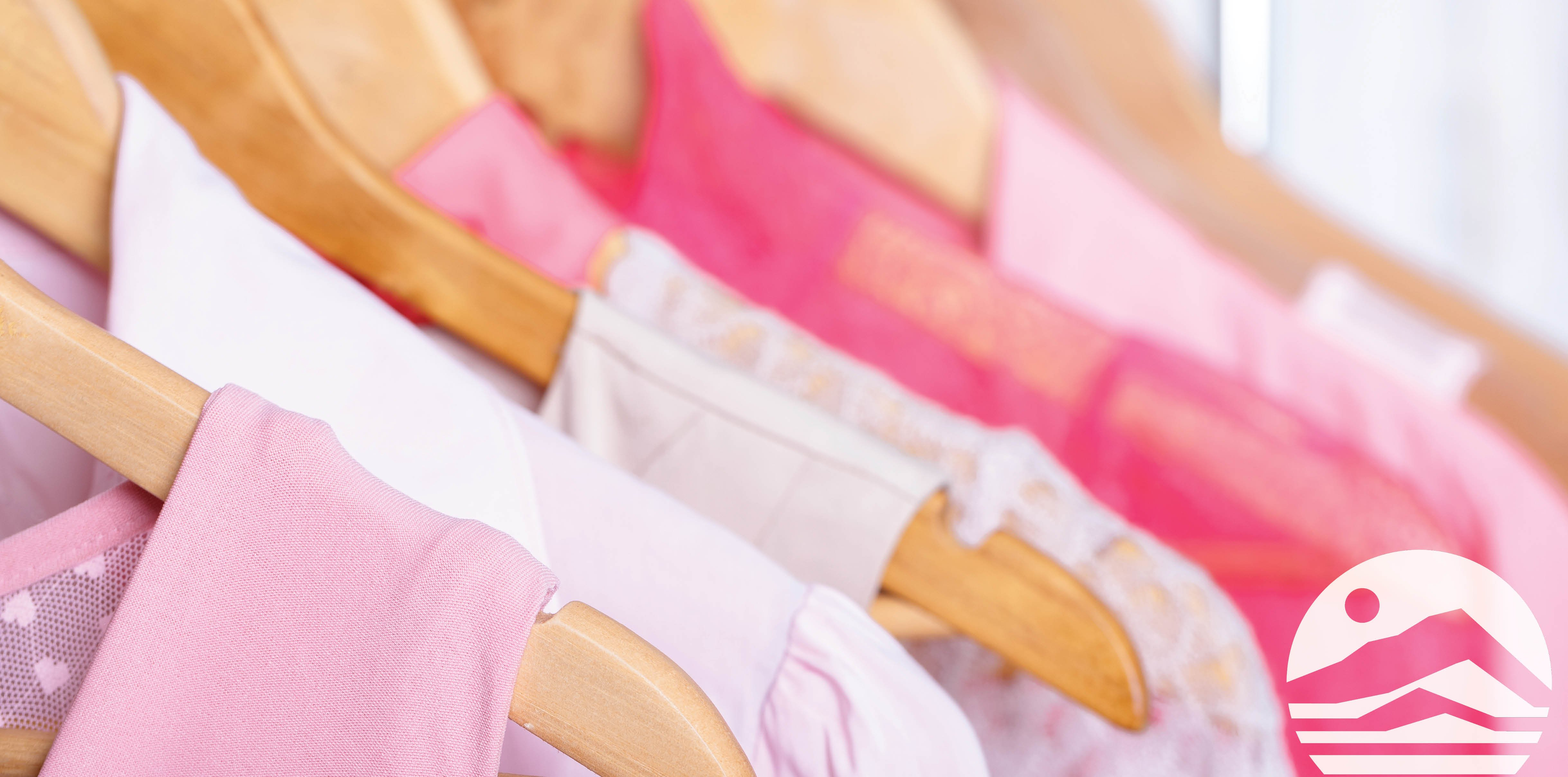 pink shirts on hangers