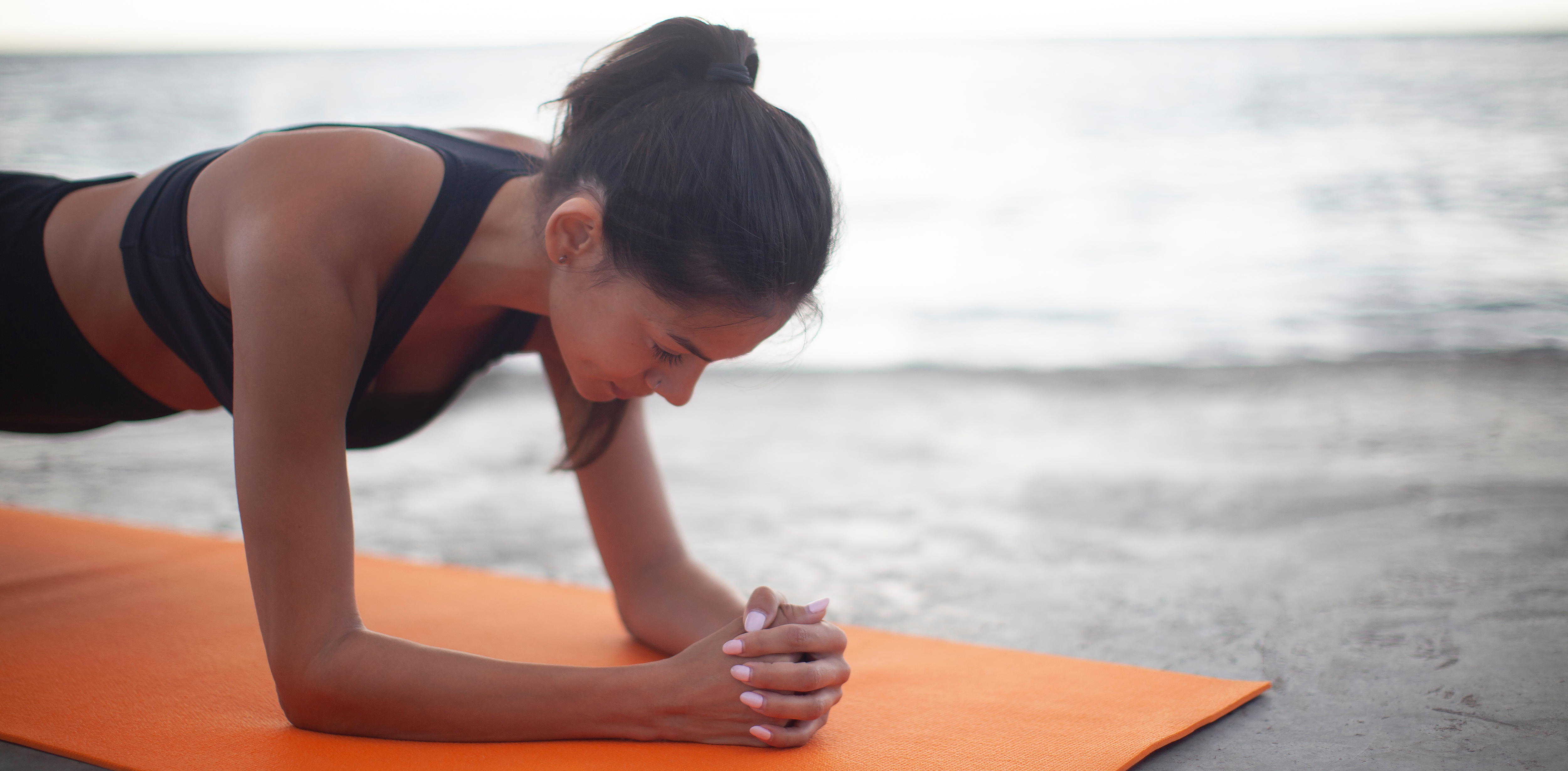 women in yoga pose